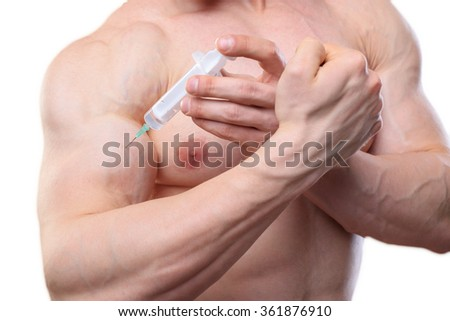 Close up shot an injection of steroids in biceps - stock photo