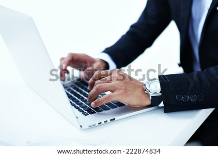 Close up shot businesspeople using modern devises for work, working man in beautiful office, businessman man using a laptop computer sitting at the table,  young manager working with his pc - stock photo