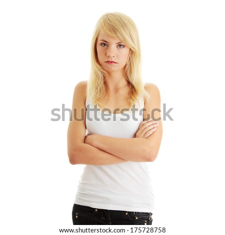 Close Up Shot of a Angry Teenager, isolated on white background   - stock photo