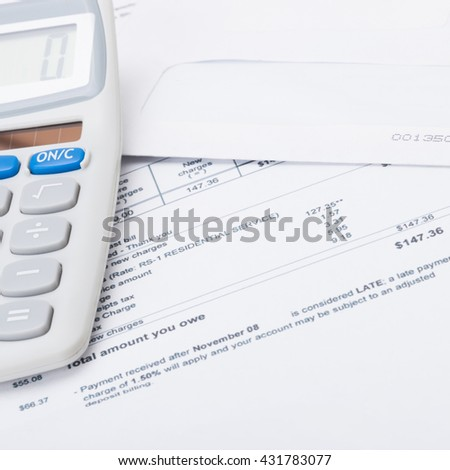 Close up shot of a calculator with utility bill under it