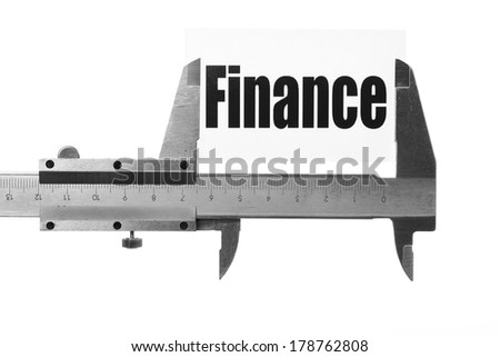 """Close up shot of a caliper measuring the word """"Finance"""" - stock photo"""