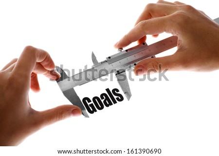 """Close up shot of a caliper measuring the word """"Goals"""" - stock photo"""