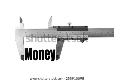"Close up shot of a caliper measuring the word ""Money"" - stock photo"