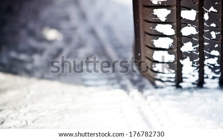 Close up shot of a car's tire in snow - stock photo