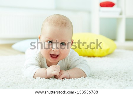 Close-up shot of a cheerful newborn enjoying himself - stock photo