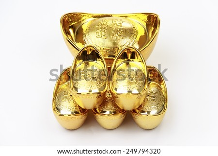 Close up shot of a Chinese gold ingot on white background - stock photo