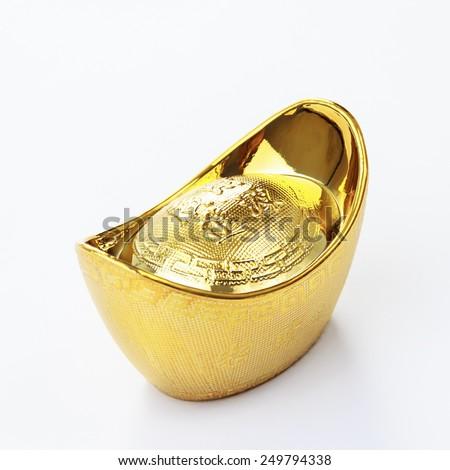 Close up shot of a Chinese gold ingot on white background - stock photo
