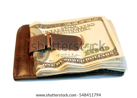close up shot of a clip wallet with cash on a white background