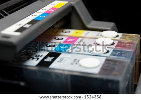 close-up shot of a CMYK ink cartridges for a color printer shallow depth of field