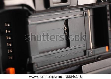 Close up shot of a film camera - stock photo