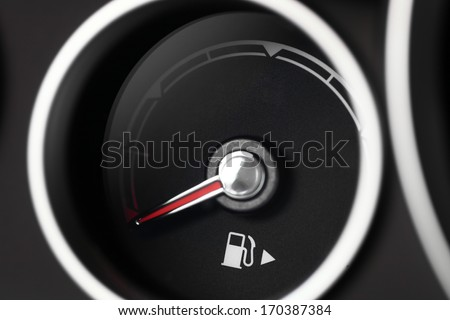 Close-up shot of a fuel gauge in a car - stock photo