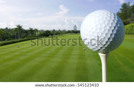 Close up shot of a golf ball on a tee at a  beautiful golf course in the countryside of Panama