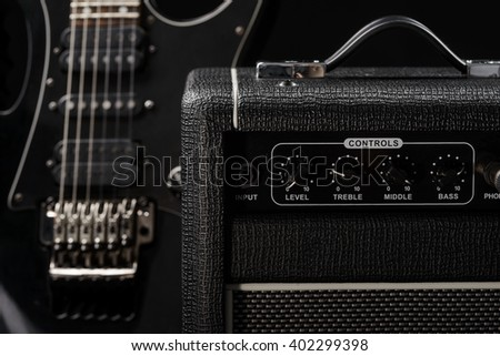 Close-up shot of a guitar amp for making a lot of noise with cool electric guitar. Neighbours from hell. Nice black color of musical equipment. - stock photo