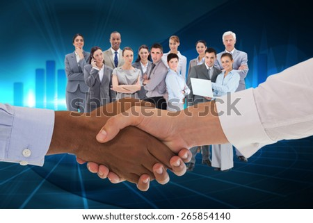 Close-up shot of a handshake in office against blue bar chart graphic with light - stock photo