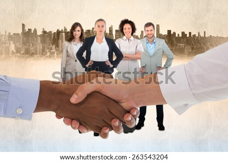 Close-up shot of a handshake in office against cityscape - stock photo