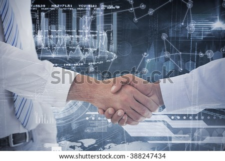 Close-up shot of a handshake in office against hologram background