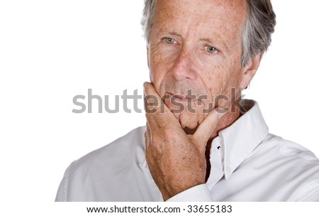 Close Up Shot of a Handsome Senior Man Looking Pensive against a White Background - stock photo