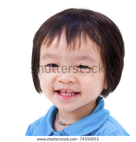 Close-up shot of a little Asian girl with smile on her face. - stock photo