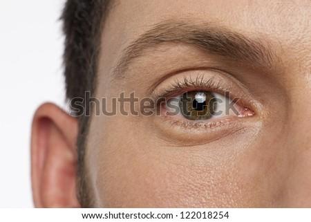 Close up shot of a man with hazel eye - stock photo