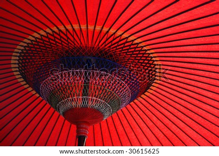 Close up shot of a nice angle of a red japanese Umbrella - stock photo
