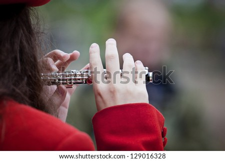 Close-up shot of a piccolo player - stock photo