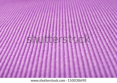 Close up shot of a purple yoga mat - stock photo