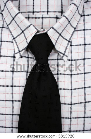 Close up shot of a shirt and a tie - stock photo