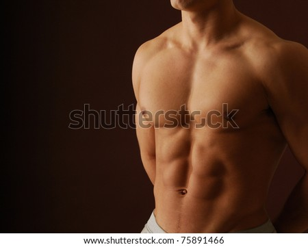 Close up shot of a shirtless male bodybuilder - stock photo