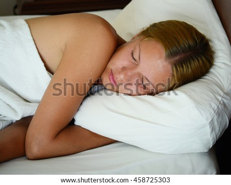 close up shot of a sleeping tanned woman