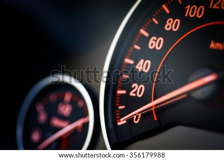 Close up shot of a speedometer in a car. - stock photo