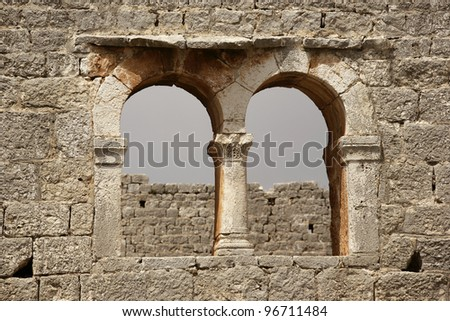 close up shot of a stone wall and window