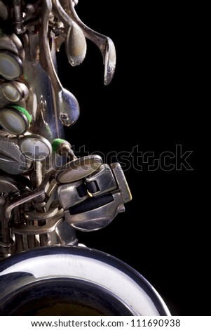 Close up shot of a vintage silver alto saxophone - stock photo