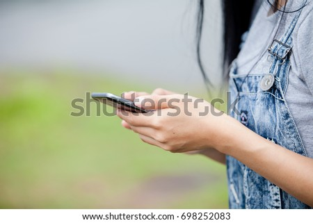 Close Up shot of a woman typing on mobile phone,woman typing text message on smart phone.
