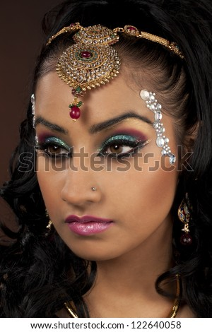 Close-up shot of a young attractive female with make-up and elegant jewelry