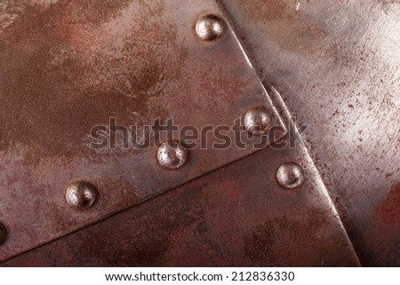 close up shot of an iron armour plate with rivets - stock photo
