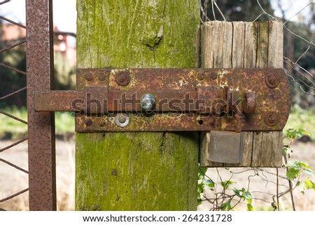 Close-up shot of an old rusty latch and lock