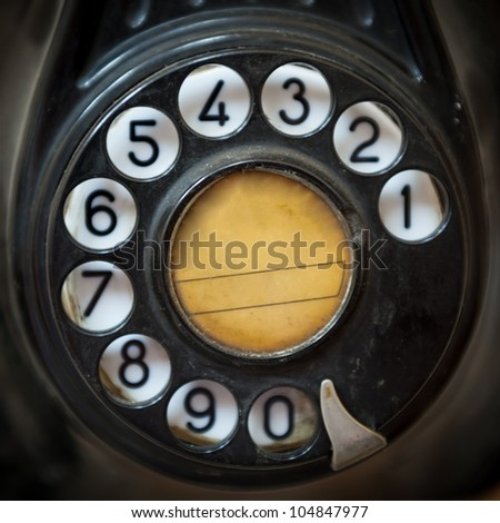 Close up shot of an old telephone dial