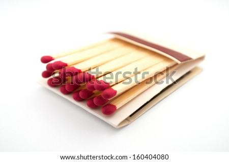 Close up shot of an open matchbook with red heads - stock photo