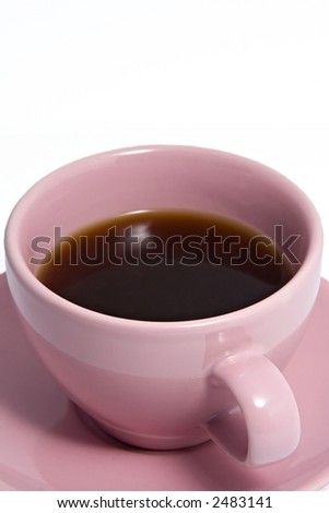 Close up shot of an pink coffee cup and saucer, containing black coffee. - stock photo