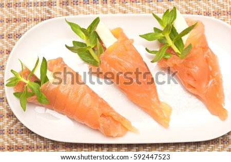 close up shot of appetizers with red fish and thyme