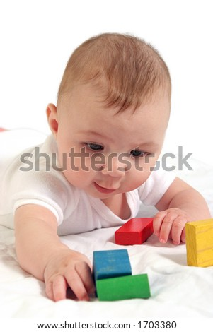 Close up shot of baby interested in colorful blocks. - stock photo