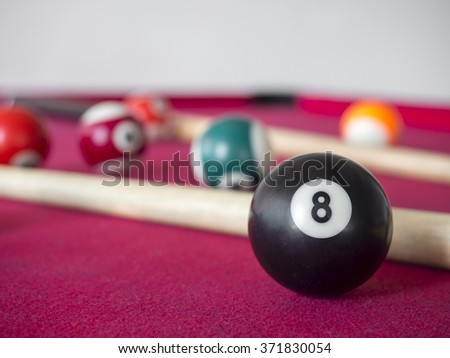 close up shot of 8 Ball from pool or billiards on a billiard table. Selective Focus.Billiard balls on the table. - stock photo