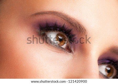 Close-up shot of beautiful female eye with bright fashion makeup - stock photo