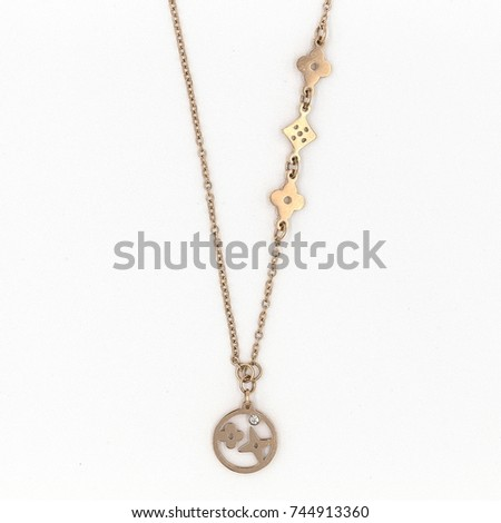 Close up shot of beautiful gold necklace background