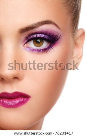 Close-up shot of beautiful woman face with stylish violet make-up - stock photo