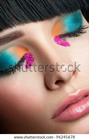 Close-up shot of beautiful woman with bright stylish make-up with closed eyes - stock photo