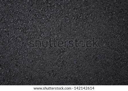 Close up shot of black asphalt background. - stock photo