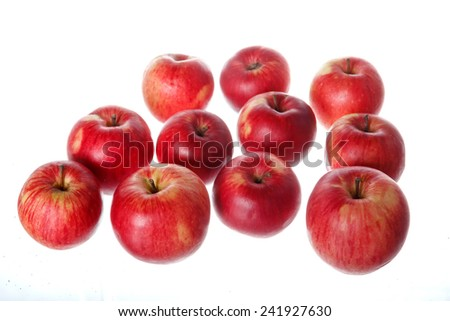 Close up shot of bunch of natural healthy tasty fresh red apples isolated on white background - stock photo