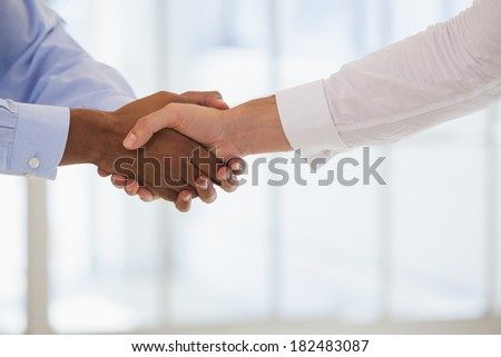 Close-up shot of business people shaking hands in the office