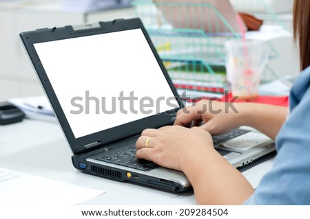 Close up shot of businesswoman pointing at her laptop - stock photo